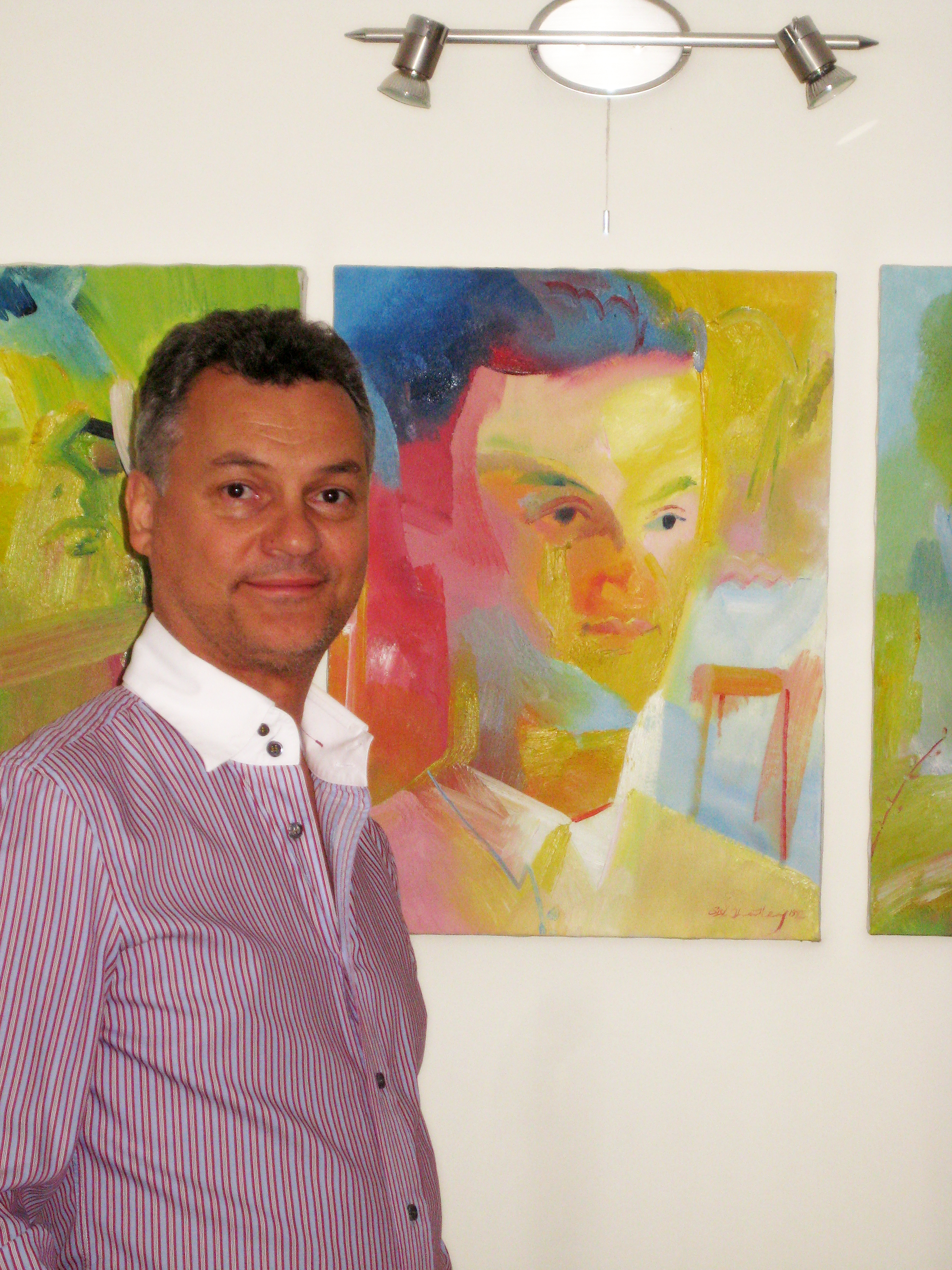Casting Director Paul De Freitas in 2002 with his 1992 portrait by Stephen B. Whatley