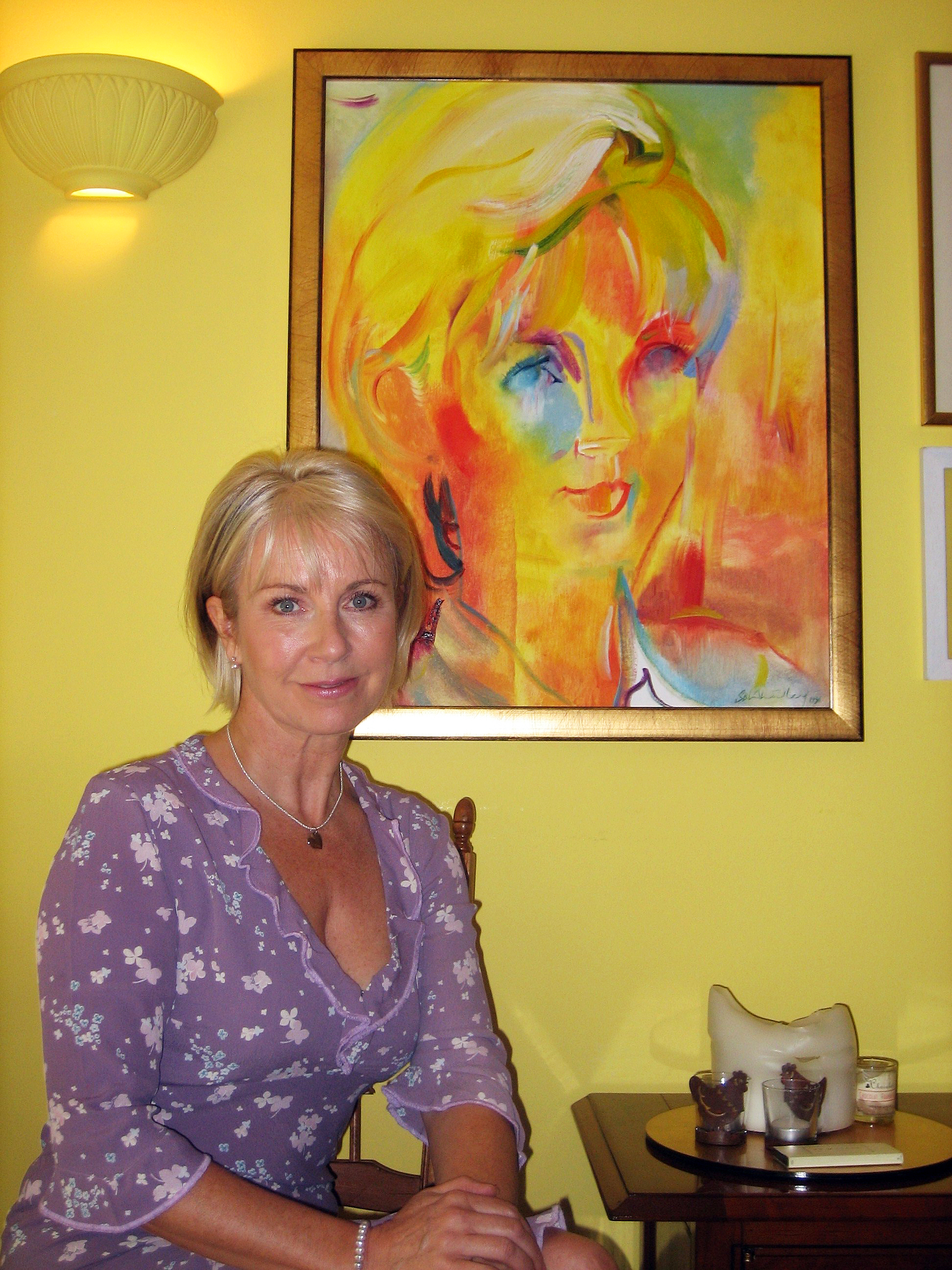 TV presenter Sarah Greene in 2006 with her 1996 portrait by Stephen B. Whatley portrait. 2006